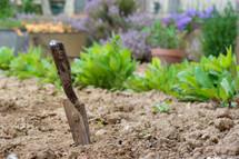 gardening shovel in a garden