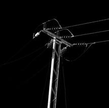 power lines against a dark sky
