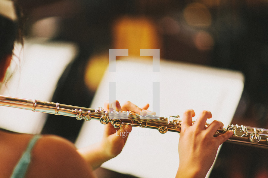 Playing the flute.