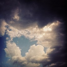 storm clouds overcoming a blue sky