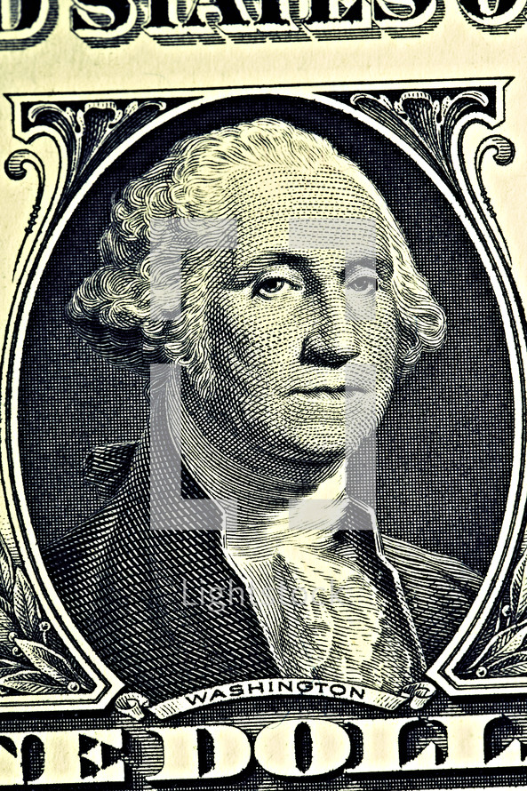 A close up of George Washington on a dollar bill
