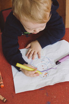 toddler boy drawing a snowman