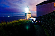 lighthouse beacon light on a coastal evening