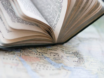 a Bible on a map