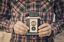 man with a box camera