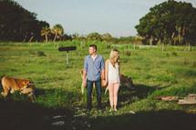 a couple on a farm holding hands
