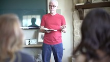 a man leading a discussion at a Bible study