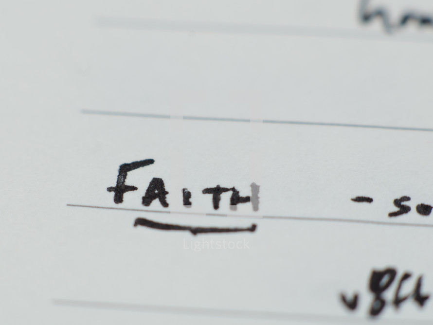 """""""Faith"""" written in ink on notebook paper."""