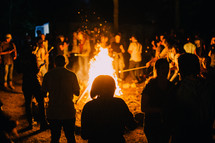 crowds around a bon fire