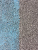 Color contrast blue and grey pavement texture