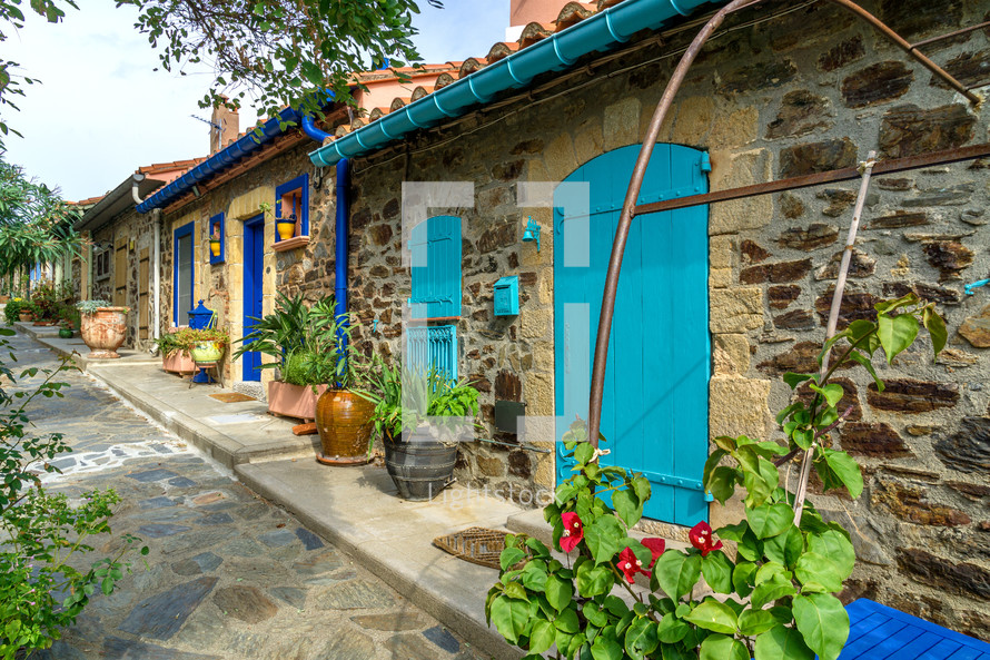 colorful doors on stone houses in a village in France