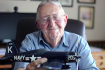 elderly man with a model airplane