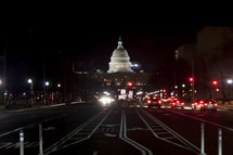streets at night leading to the US Capital building
