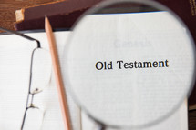 magnifying glass over Old Testament