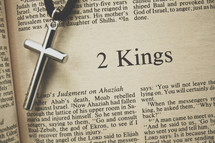 2 Kings and a cross necklace