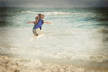 Child playing on the seashore.