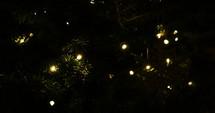 white bokeh lights on a Christmas tree