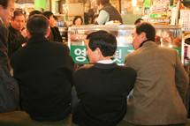 men eating at a Korean restaurant