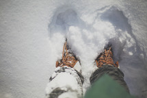 looking down at my boots in the deep snow