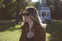 brunette woman wearing sunglasses outdoors