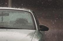 downpour of rain bounces off a vehicle