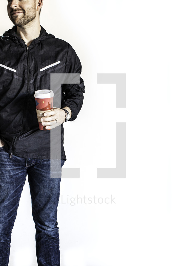 man holding a coffee travel mug