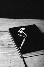 ear buds lying on a Bible