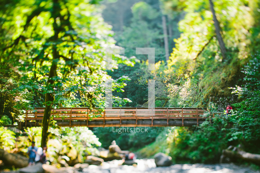 people below a foot bridge