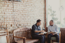 men reading a Bibles at a Bible study