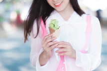 a girl holding an ice cream cone