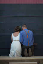 bride and groom kneeling in prayer