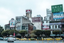 taxi cabs and buildings along a street in Taiwan