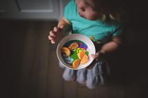 toddler girl eating a snack