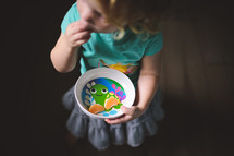 a toddler eating a snack