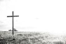 Empty cross at sunrise