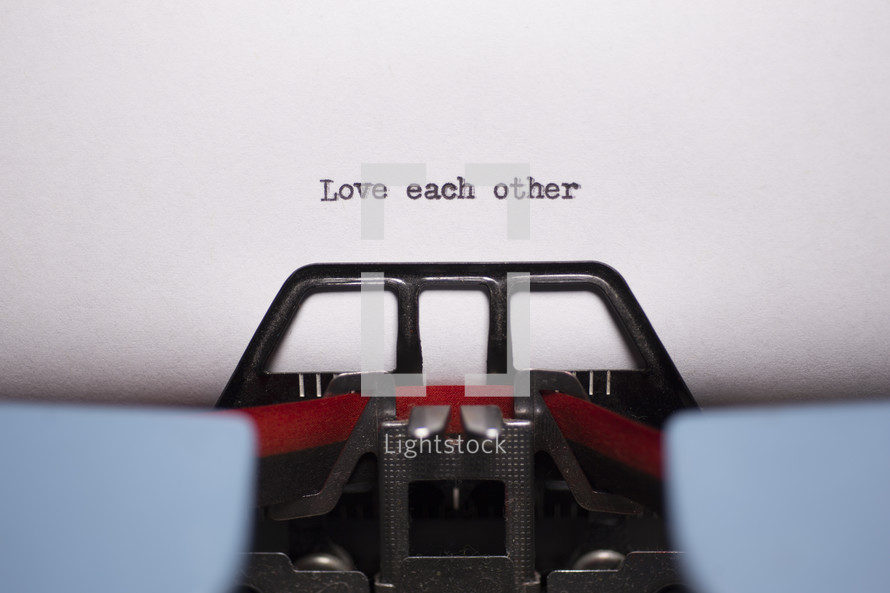 words love each other typed on a typewriter