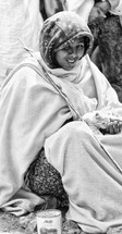 woman sitting with a kitten in her lap in Ethiopia