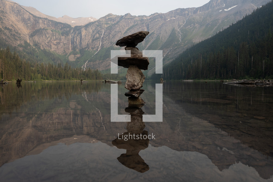 stacked rocks in a lake