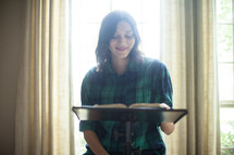 A young woman leading a Bible study.