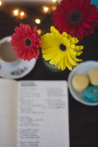 gerber daisies and journal with cookies and coffee
