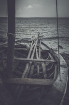 sticks in a wooden boat