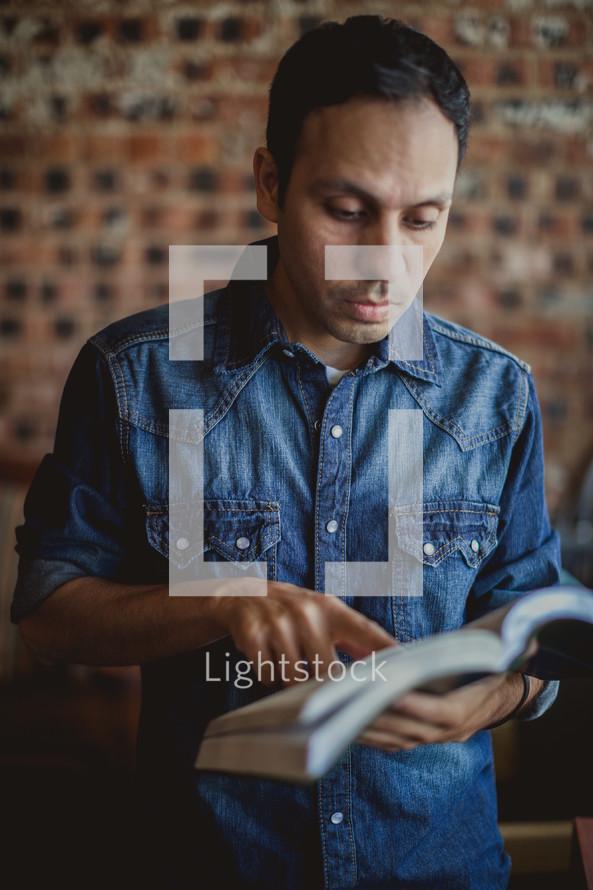 Latino man reading a Bible