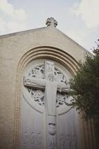 A crucifix sculpture as part of a church building's architecture