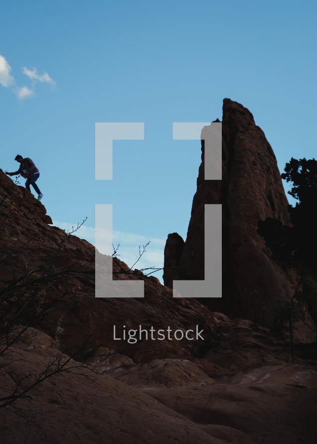 climbing red rock peaks