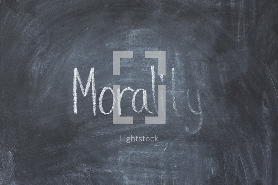erasing the word morality off a chalkboard