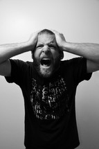 an angry and frustrated man screaming