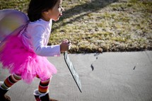 a child dressed as a fairy