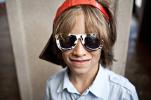 Boy wearing sunglasses and visor