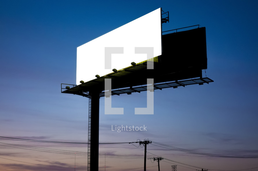 a blank billboard sign at sunset