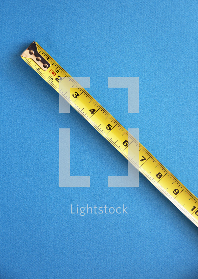 measuring tape on a blue background
